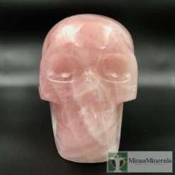 Life-size rose quartz skull